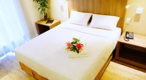 Um dos quartos do The Hotel